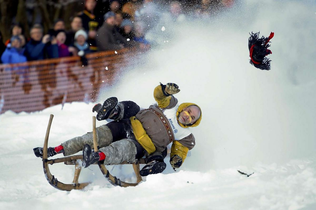 """A participant  steers a wooden sledge during a traditional Bavarian horn sledge race, known as """"Schnablerrennen"""", in Gaissach near Bad Toelz, Germany, January 22, 2017. PHOTO: REUTERS"""