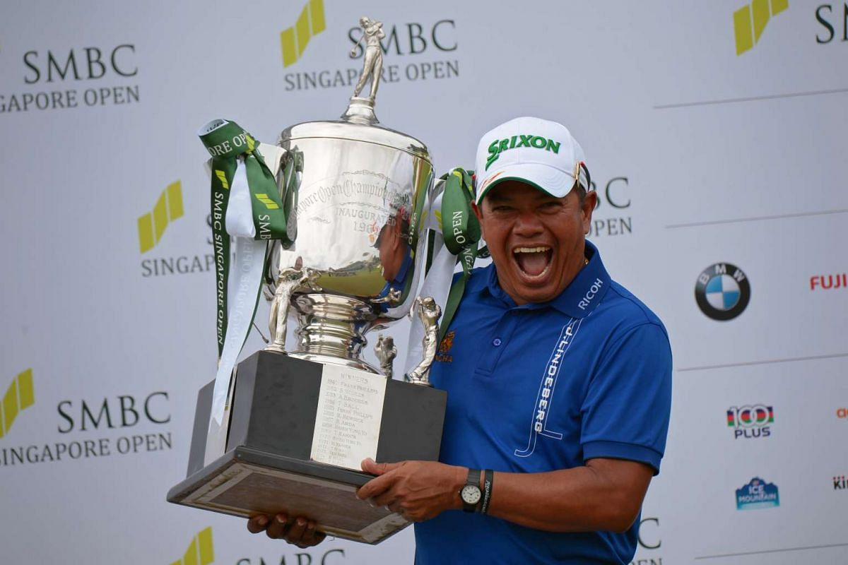 Prayad Marksaeng showing off his trophy after winning the SMBC Singapore Open on January 22, 2017. At 50, the Thai golfer is the oldest winner of the US$1 million (S$1.43 million) tournament. ST PHOTO/MARK CHEONG