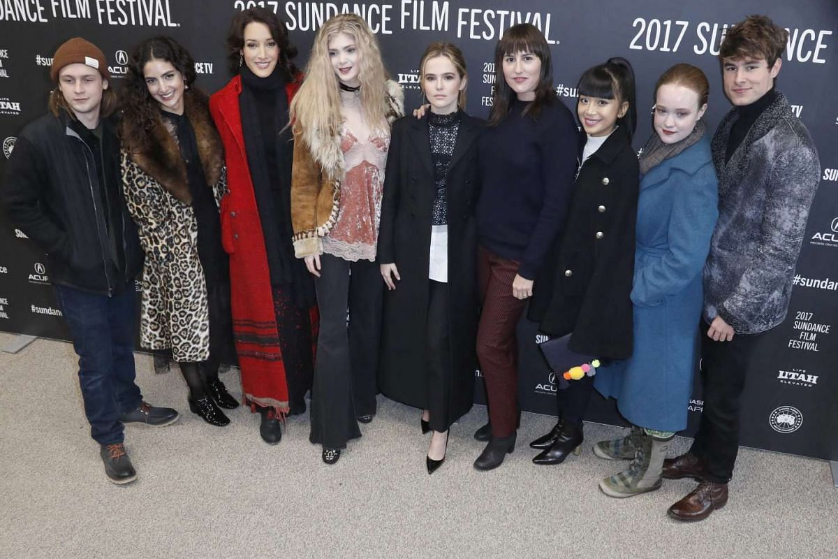 The cast of Before I Fall: (From left) Logan Miller, Medalion Rahimi, Jennifer Beals, Elena Kampouris, Zoey Deutch, Ry Russo-Young, Cynthy Wu, Liv Hewson and Kian Lawley pose as they arrive for the premiere of the movie at the 2017 Sundance Film Fest