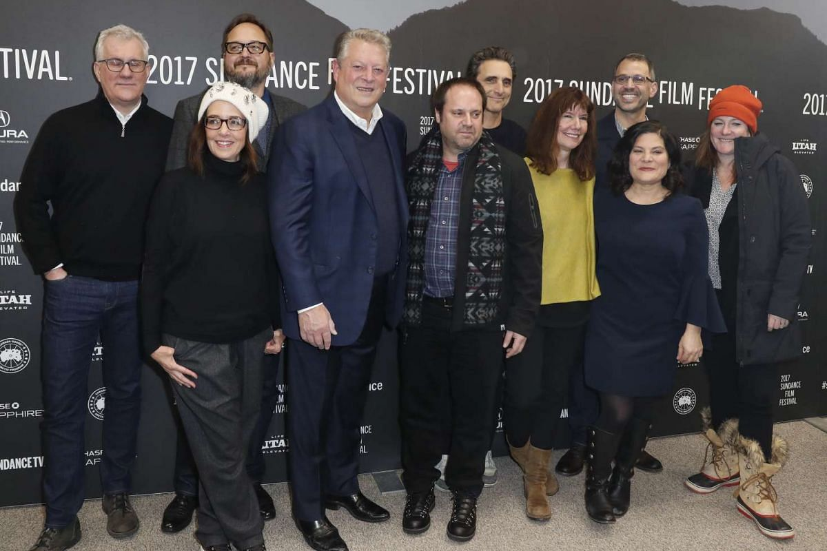 Former Vice President of the United States and cast member Al Gore (centre) poses for a photo with directors and producers before the premiere of An Inconvenient Sequel: Truth To Power at the 2017 Sundance Film Festival, on Jan 19, 2017.