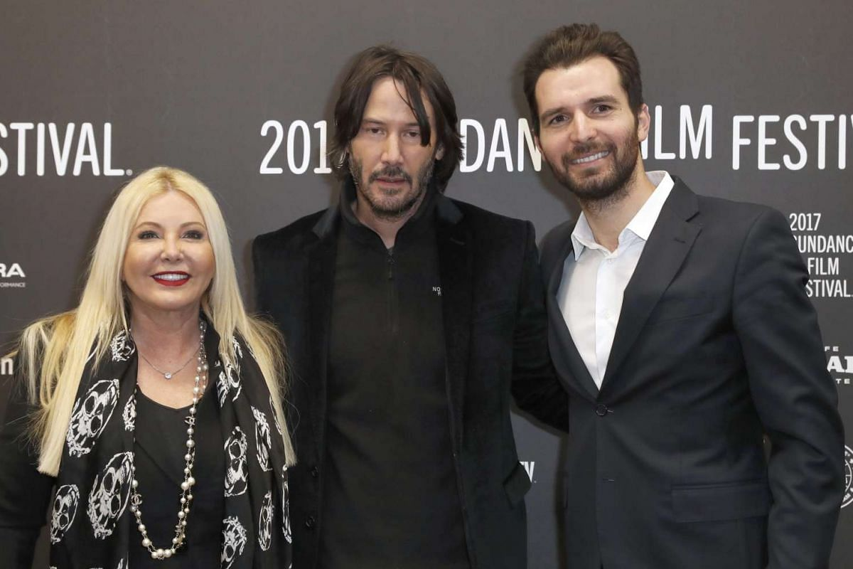 Producers Monika Bacardi (left) and Andrea Iervolino (right), alongside actor Keanu Reeves, arrive for the premiere of To The Bone at the 2017 Sundance Film Festival in Park City, Utah, on Jan 22, 2017.