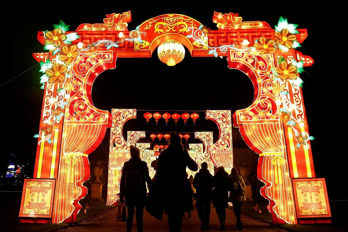 BRITAIN: Pedestrians silhouetted against a light display during The Magical Lantern Festival to mark the Chinese New Year at Chiswick House in London. CHINA: Decorations are up for the upcoming Year of the Rooster at the Oriental Plaza in Beijing. PO