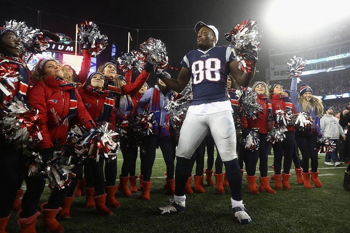 Martellus Bennett of the New England Patriots celebrates with cheerleaders after defeating the Pittsburgh Steelers 36-17 to win the AFC Championship Game at Gillette Stadium on Jan 22, 2017, in Foxboro, Massachusetts.
