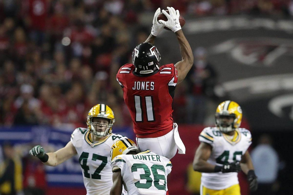 Julio Jones of the Atlanta Falcons makes a catch in the third quarter against Jake Ryan and LaDarius Gunter of the Green Bay Packers in the NFC Championship Game at the Georgia Dome on Jan 22, 2017, in Atlanta, Georgia.