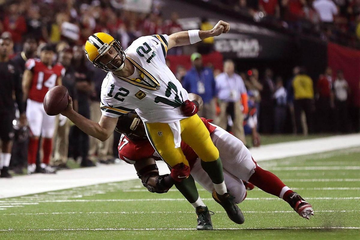 Aaron Rodgers of the Green Bay Packers is tackled by Grady Jarrett of the Atlanta Falcons, as he attempts a pass in the fourth quarter in the NFC Championship Game at the Georgia Dome on Jan 22, 2017, in Atlanta, Georgia.