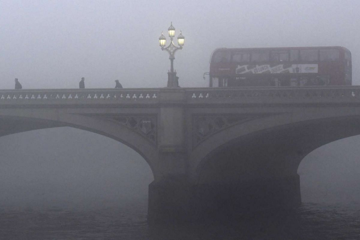 A bus travelling over Westminster Bridge.