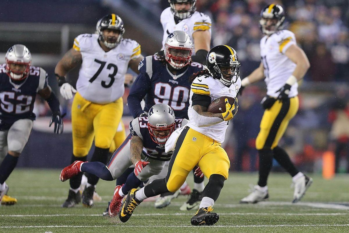 DeAngelo Williams of the Pittsburgh Steelers is pursued by Patrick Chung of the New England Patriots during the second quarter in the AFC Championship Game at Gillette Stadium on Jan 22, 2017, in Foxboro, Massachusetts.