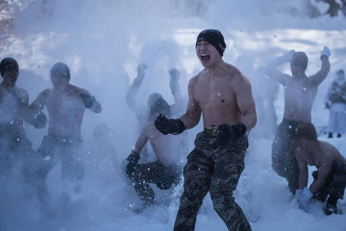 South Korean and US soldiers throwing snow on themselves as they perform a demonstration for the media during a joint annual winter exercise in Pyeongchang, on Jan 24, 2017.