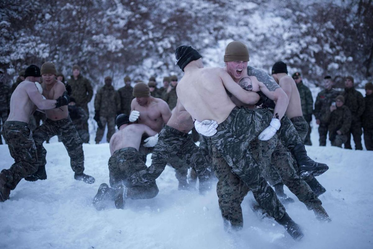 South Korean and US soldiers wrestling as they perform a demonstration for the media during a joint annual winter exercise in Pyeongchang, on Jan 24, 2017.