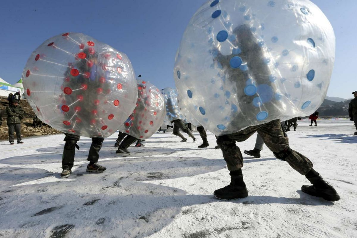 Soldiers engaging in a bubble battle during an annual ice fishing festival in Inje, on Jan 24, 2017.