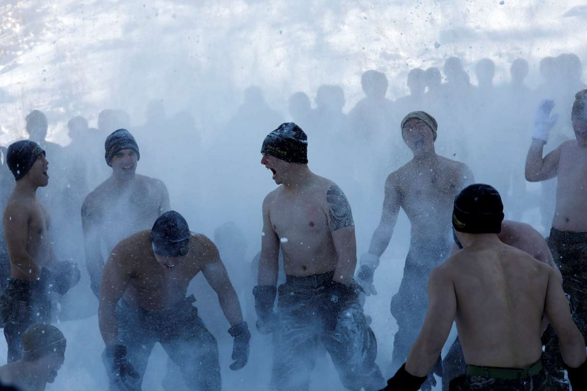 South Korean and US Marines hurling snow as they participate in a winter military drill in Pyeongchang, on Jan 24, 2017.