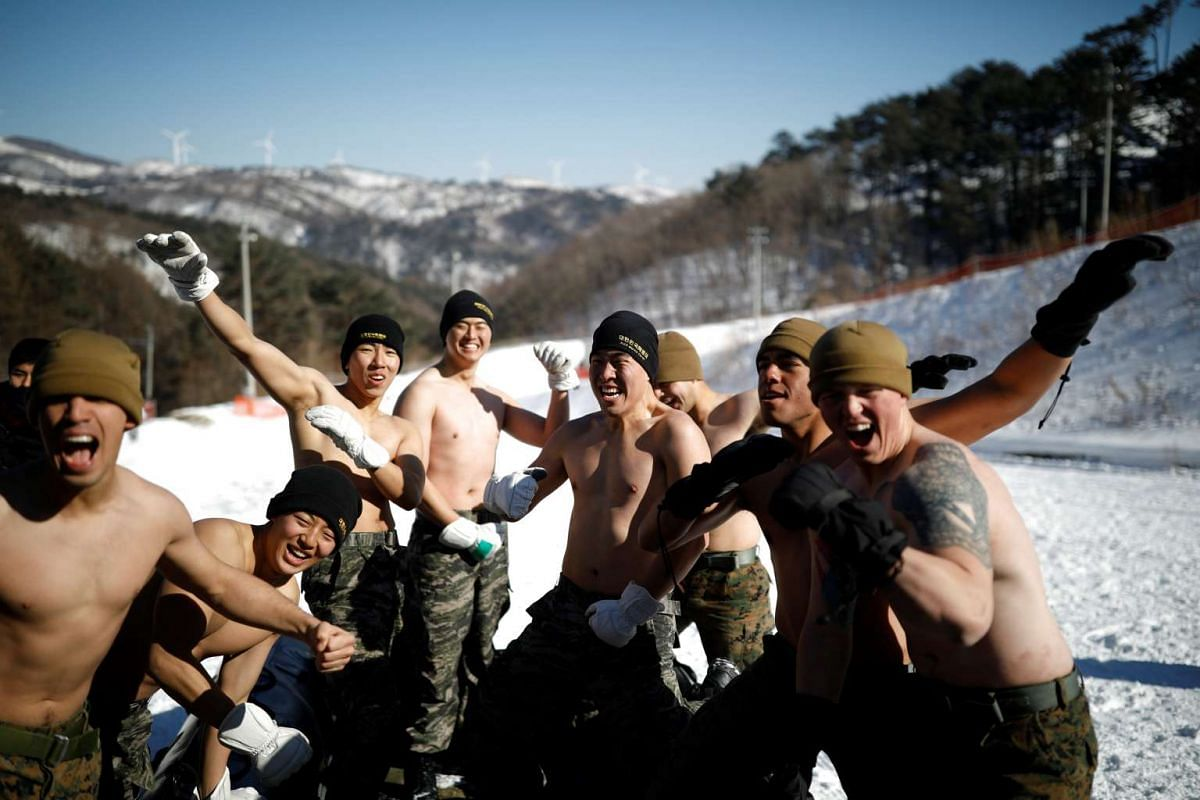 South Korean and US Marines reacting as they participate in a winter military drill in Pyeongchang, on Jan 24, 2017.