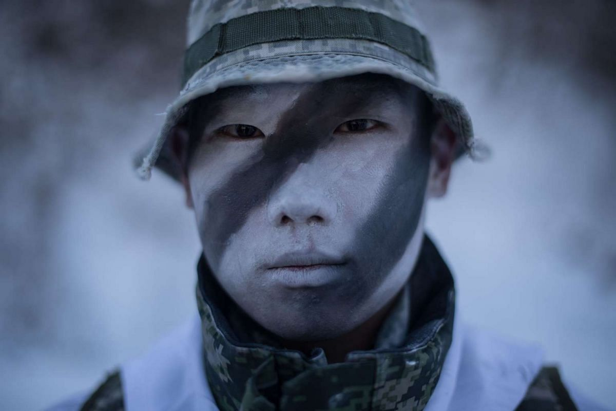 A soldier posing for a photo as South Korean and US soldiers perform a demonstration for the media during a joint annual winter exercise in Pyeongchang, on Jan 24, 2017.