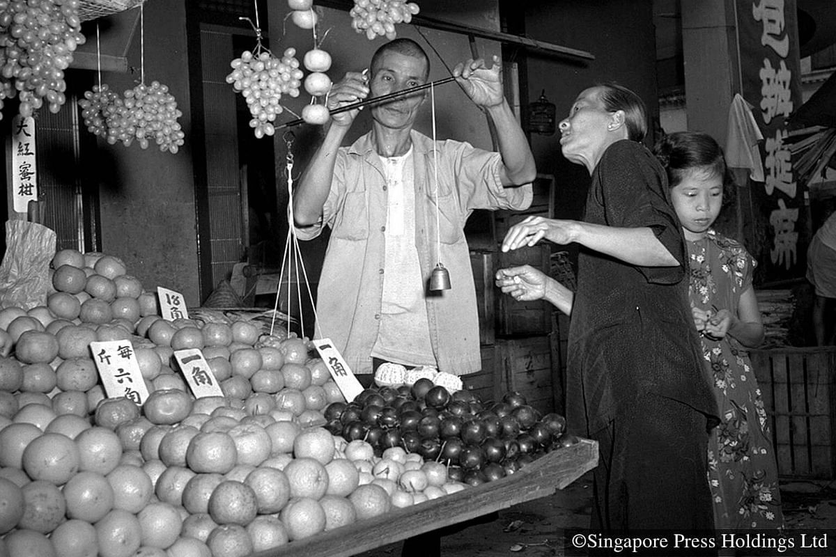 "1955: Tangerines and oranges are auspicious Chinese New Year symbols and a must-have celebration item. Tangerines in Chinese sound similar to the word ""luck"" or ji, and orange sounds like the Chinese word for ""success"" or cheng. Through the play of w"