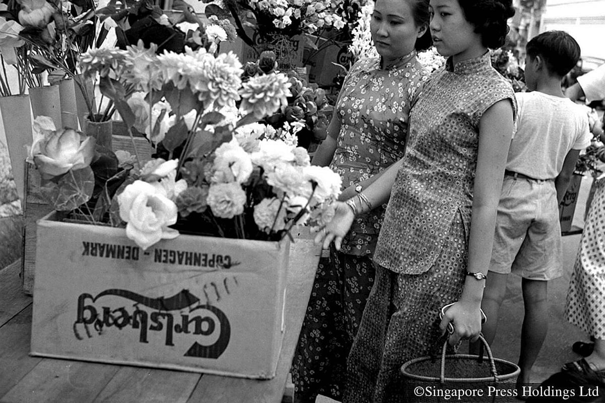 1955: Chinese New Year would not be complete without decorating the home with flowers such as peonies, pussy willows and peach blossoms.