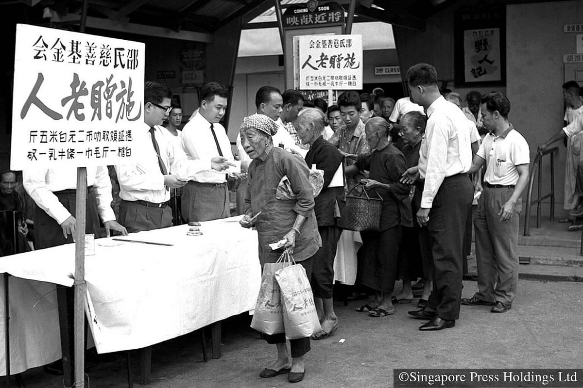 1964: The old and poor are not forgotten and they receive Hongbao from big businesses like Shaw Brothers.