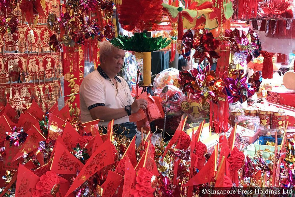 2017: Many Singaporeans create a festive atmosphere in their homes and offices by putting up such Chinese New Year decorations.