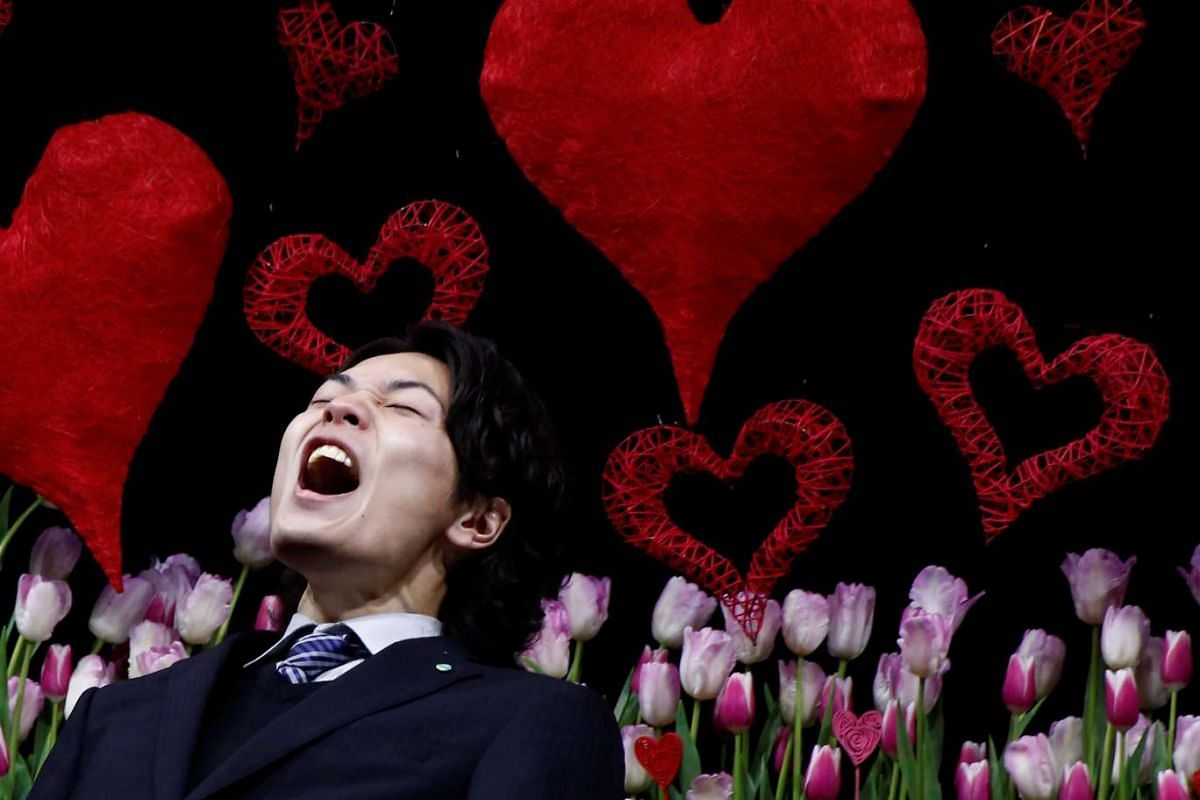 A man shouts as he expresses his love to his lover on a stage at an annual event organized for men shouting their love to their wives or girlfriends, publicly at a park in Tokyo, Japan, January 25, 2017. PHOTO: REUTERS