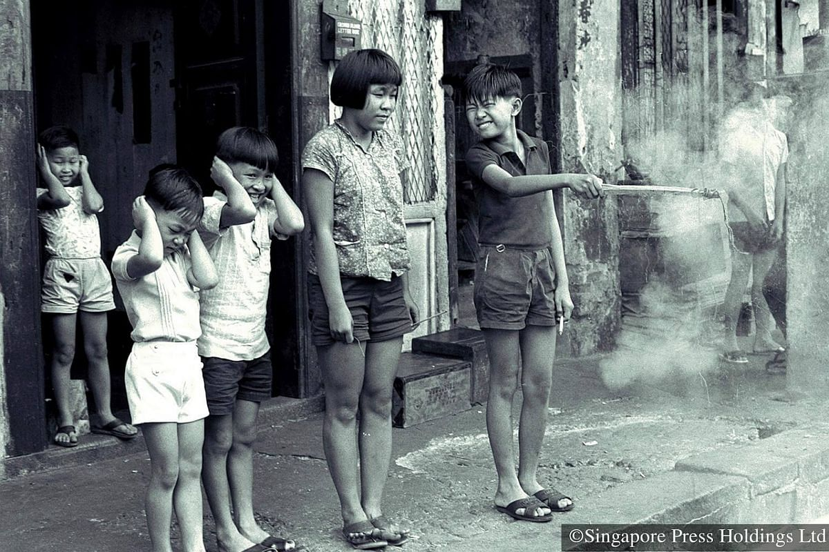1971: Children usher in the new year with a bang by letting off firecrackers. It is believed that the loud noises from the firecrackers would scare away evil spirits. But firecrackers were outlawed in Singapore under the Dangerous Fireworks Act in 19