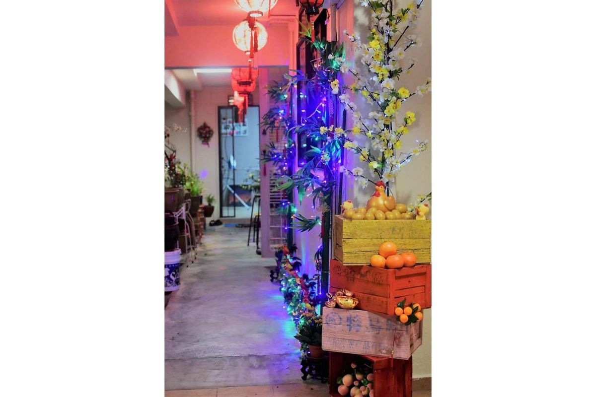 Ms Linda Cheng decorated the corridor outside her Bedok Reservoir flat in festive lanterns, flowers, chickens and golden eggs for the Chinese New Year.