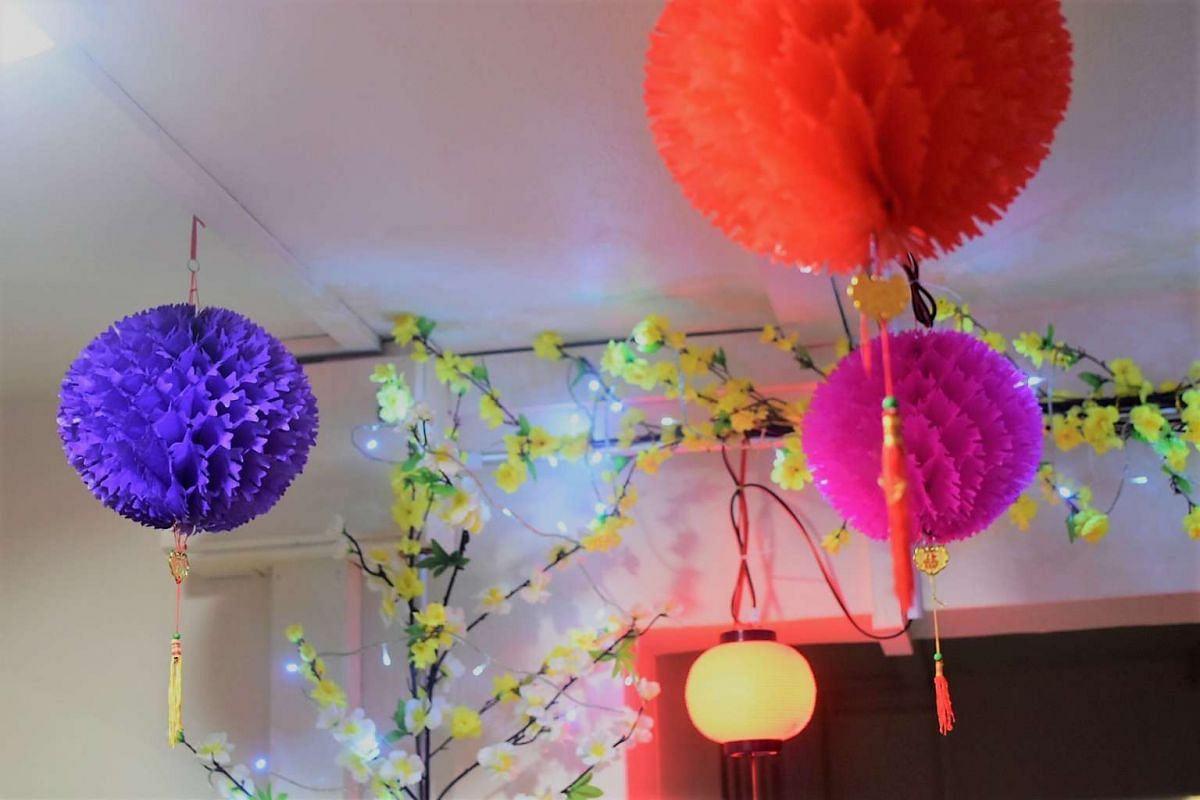 Festive lanterns hang above the corridor outside Ms Linda Cheng's Bedok Reservoir flat.