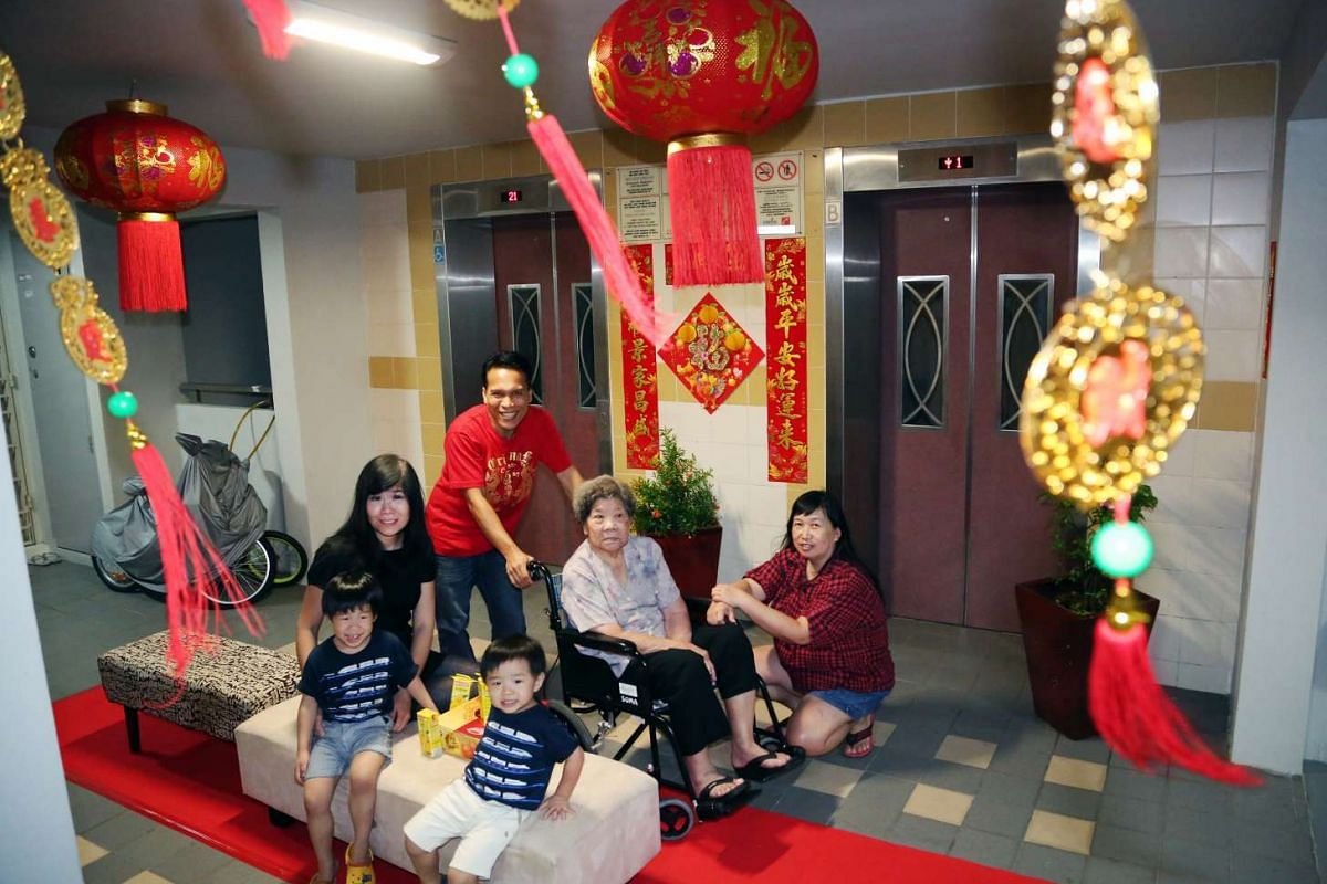 A photo of Mr Hamzah Osman with his neighbours. Every festive season, he decorates the corridor of his HDB level at Blk 700B, Ang Mo Kio Avenue 6.