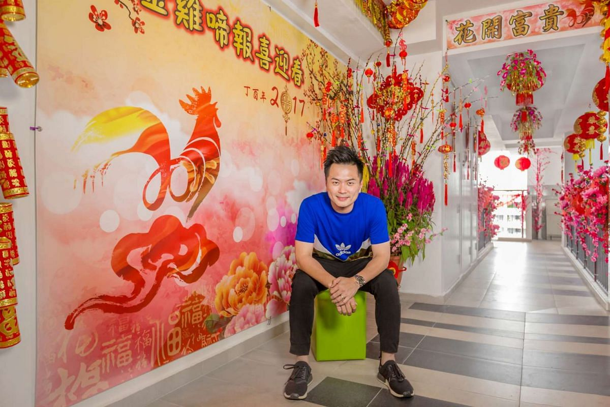 Getai organiser Aaron Tan spends $2,000 to decorate flat corridor to celebrate Chinese New Year with neighbours.