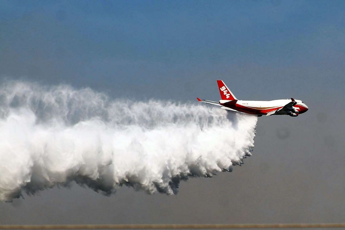 The 747 SuperTanker discharges water on a forest fire located in Huala, Maule Region, on Jan 25, 2017.