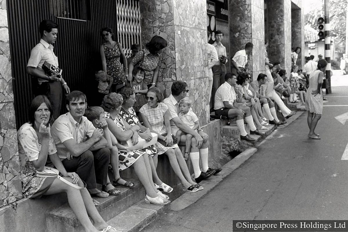1973: People of different races and nationalities gathering to watch the street procession.