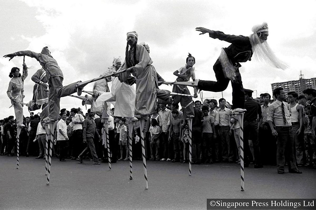 1973: Stilt walkers are one of the highlights of the parade. Performers dressed in Chinese period costumes display acrobatic moves on long peppermint striped stilts. The parade is telecast live on television.