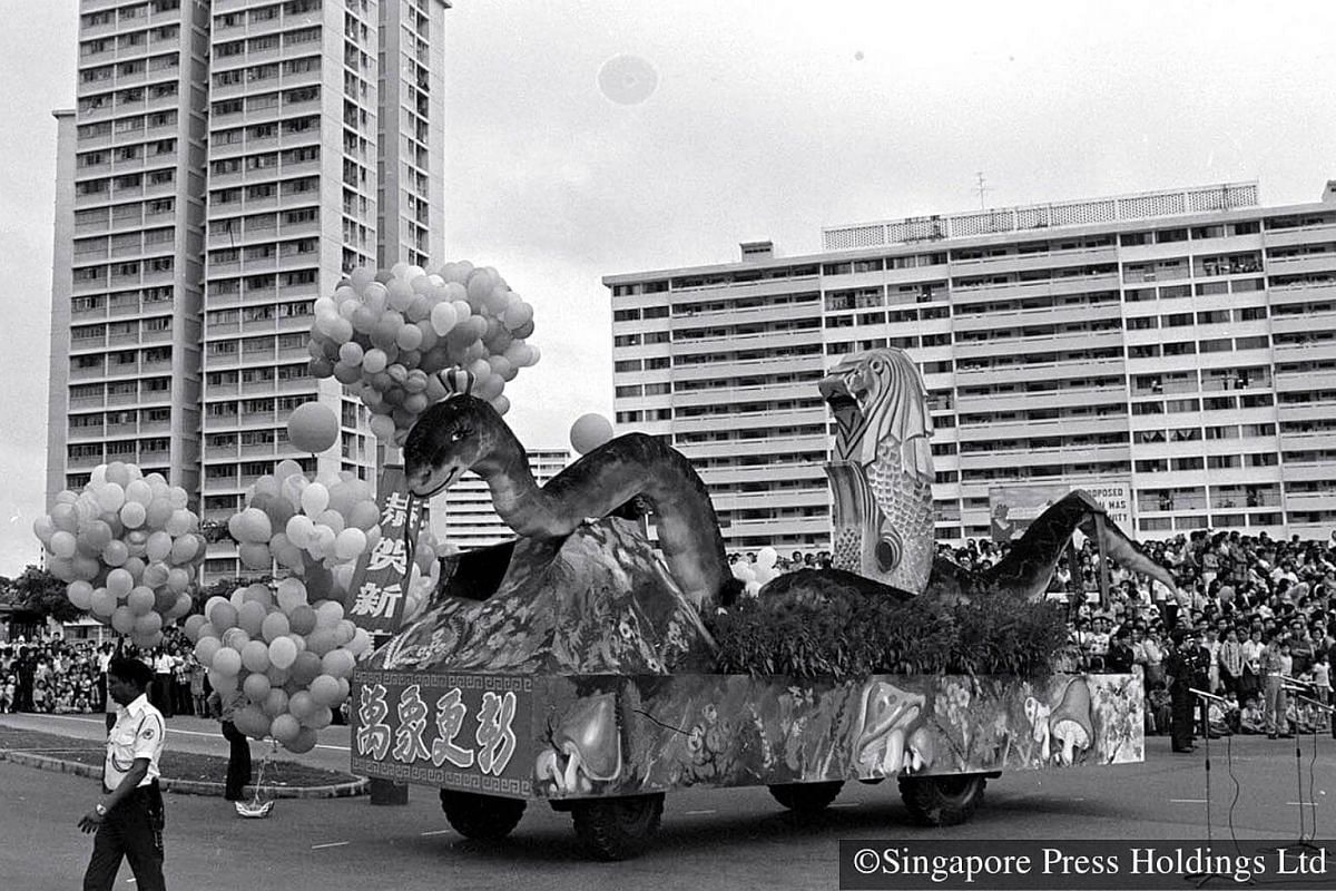 1973: A statue of the Merlion on a float. Resident from the flats enjoying a wonderful view of the parade.