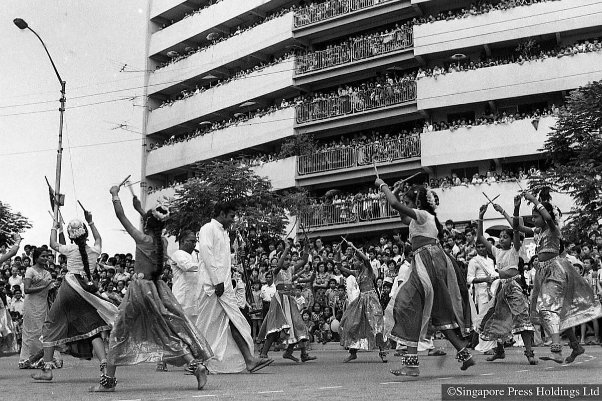 1976: Over 1,500 participants, including these Indian dancers, taking part in the parade. The procession follows a route from Circuit Road to Sims Avenue. The parade takes on a multicultural flavour from this year.