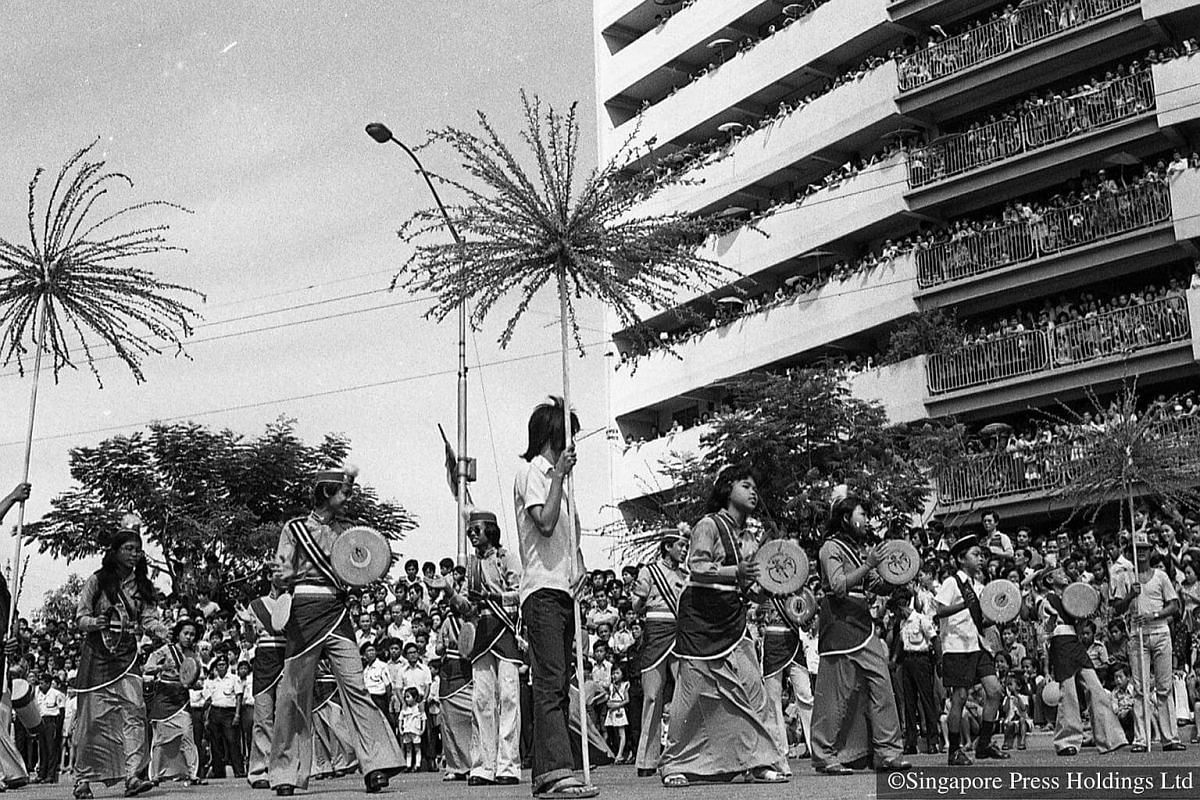 1976: Malay participants beating their kompang (traditional drums) as they add to the colour and sound of the procession.
