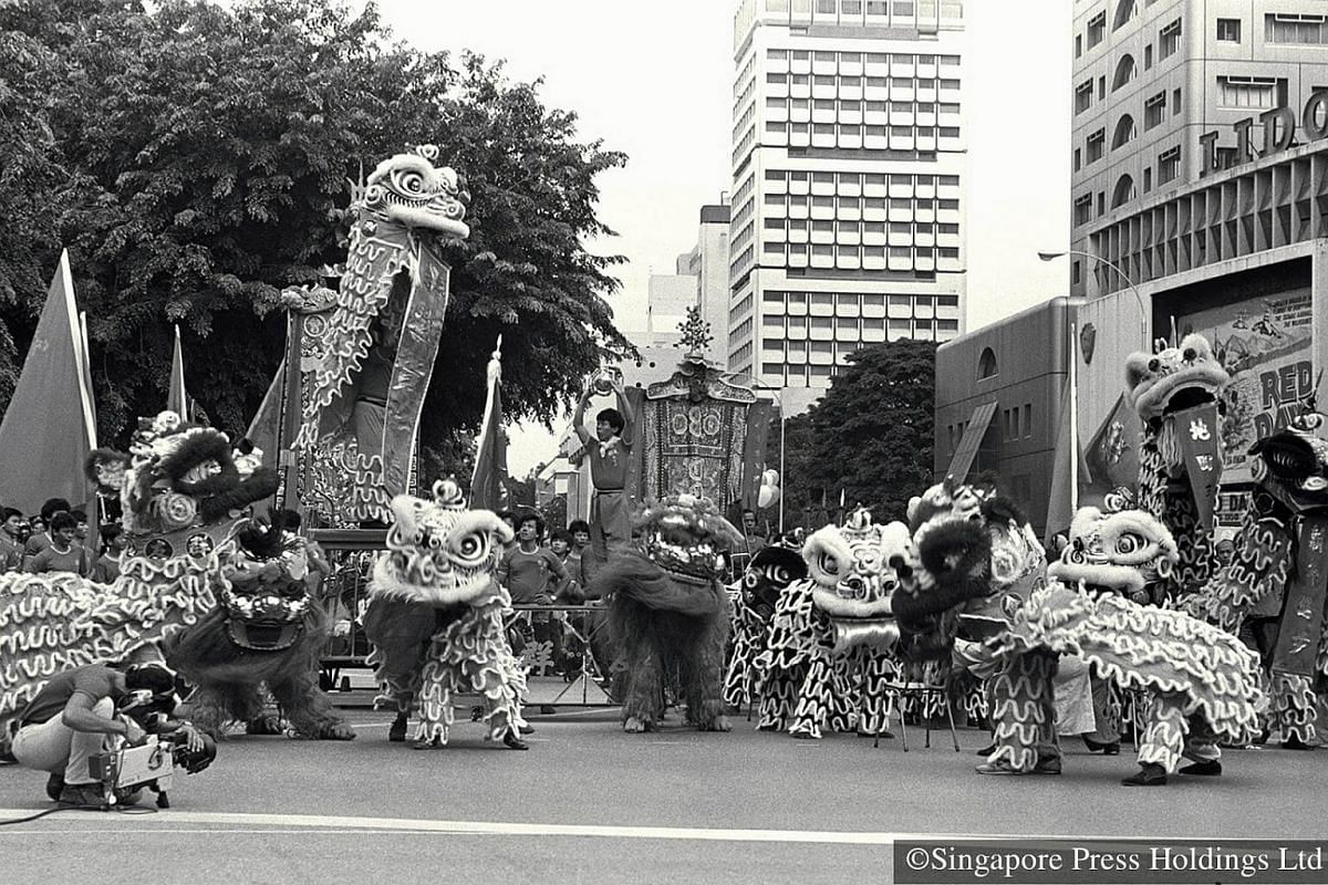 1985: Prancing lions in Orchard Road. The parade makes its debut in downtown Singapore, and some spectators, eager to get the best view, are there early in the morning long before the show begins. Besides crowd favourites such as stilt walkers, and l