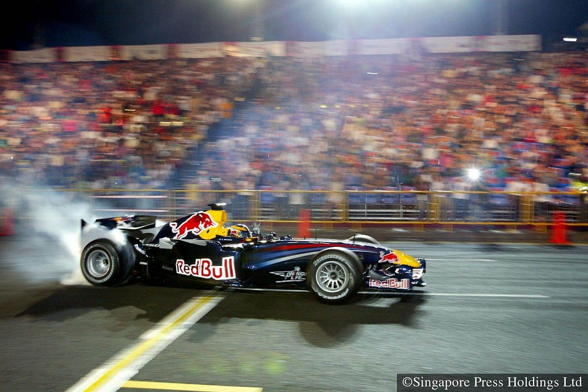 2008: A Red Bull Formula One (F1) racing car adding to the excitement of the parade at City Hall. The car is making an appearance to promote the F1 night race, to be held later in the year in Singapore.