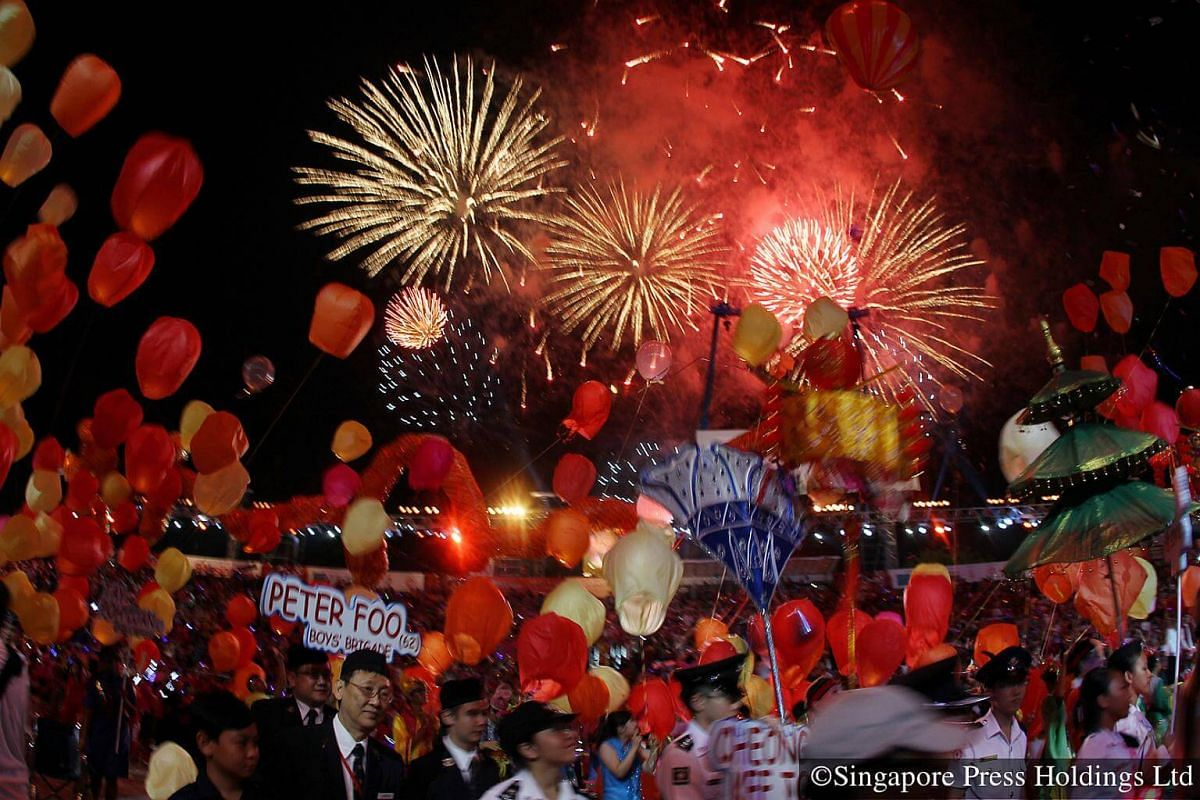 2011: With a spectacular background of fireworks in the sky, thousands of lanterns are being released at the end of the Chingay parade at the F1 Pit Building. The parade made a permanent move to the Marina Bay area in 2010 to accommodate bigger crowd