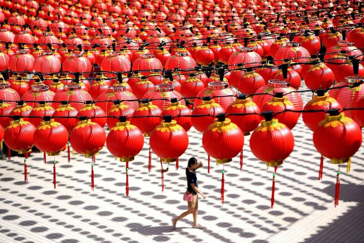 A woman walks under traditional Chinese lanterns decorated at the Thean Hou temple ahead of Chinese New Year celebrations in Kuala Lumpur on Jan 17.