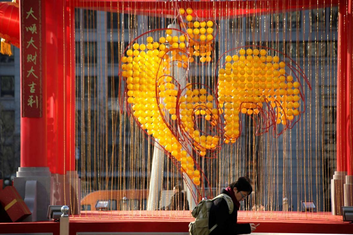 Decorations are placed to celebrate the Year of the Rooster at Oriental Plaza in Beijing, China in this photo taken on Jan 18.