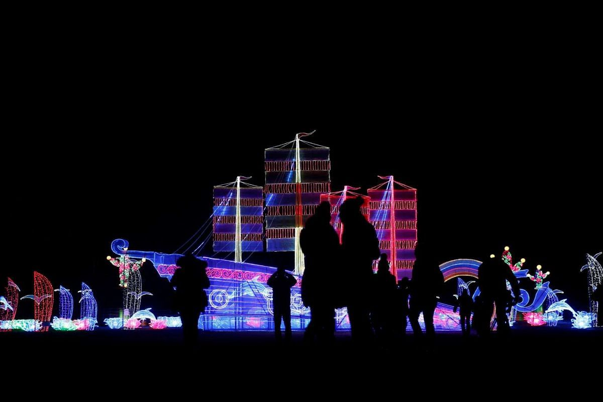People watch a light display during The Magical Lantern Festival marking Chinese New Year at Chiswick House in London on Jan 18.