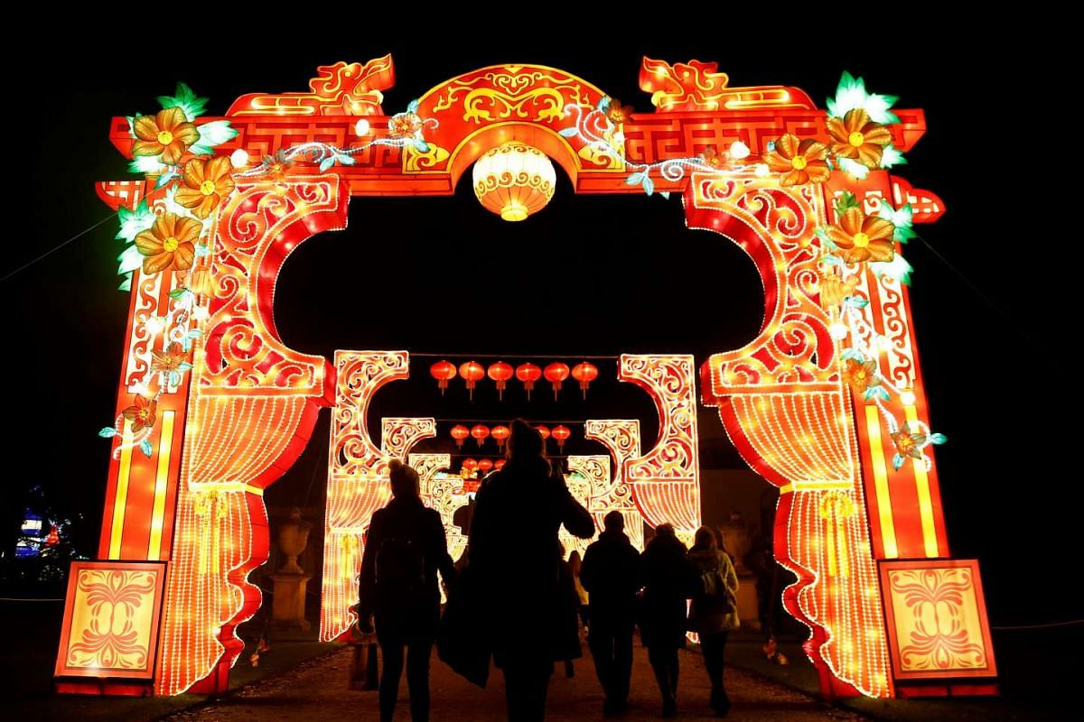 People are silhouetted against a light display during the The Magical Lantern Festival marking the Chinese new year at Chiswick House in London on Jan 18.