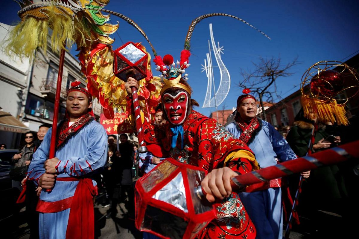 Dancers perform during a parade to celebrate Chinese New Year in Lisbon, Portugal on Jan 21.