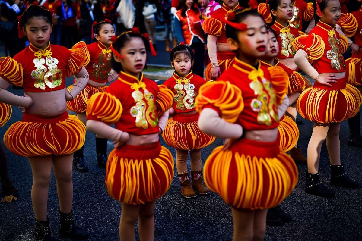 Children wearing costumes take part in the Chinese New Year parade marking the Year of the Rooster, in Lisbon on Jan 21.