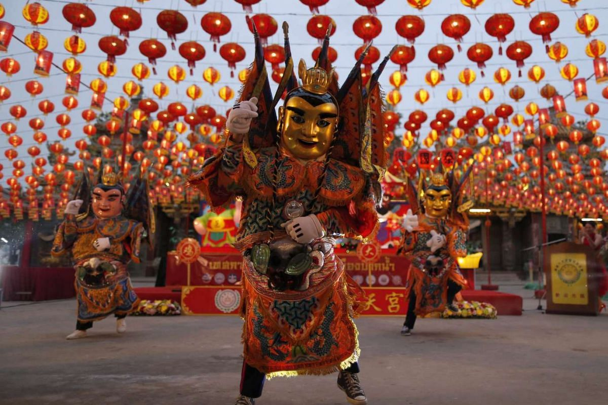 Thai performers, dressed in costumes as Nezha - a Chinese deity - dancing to mark the start of Chinese Lunar New Year celebrations at Siam Tai Tien Kong shrine in Samut Prakan province, on the outskirts of Bangkok, Thailand, on Jan 21.