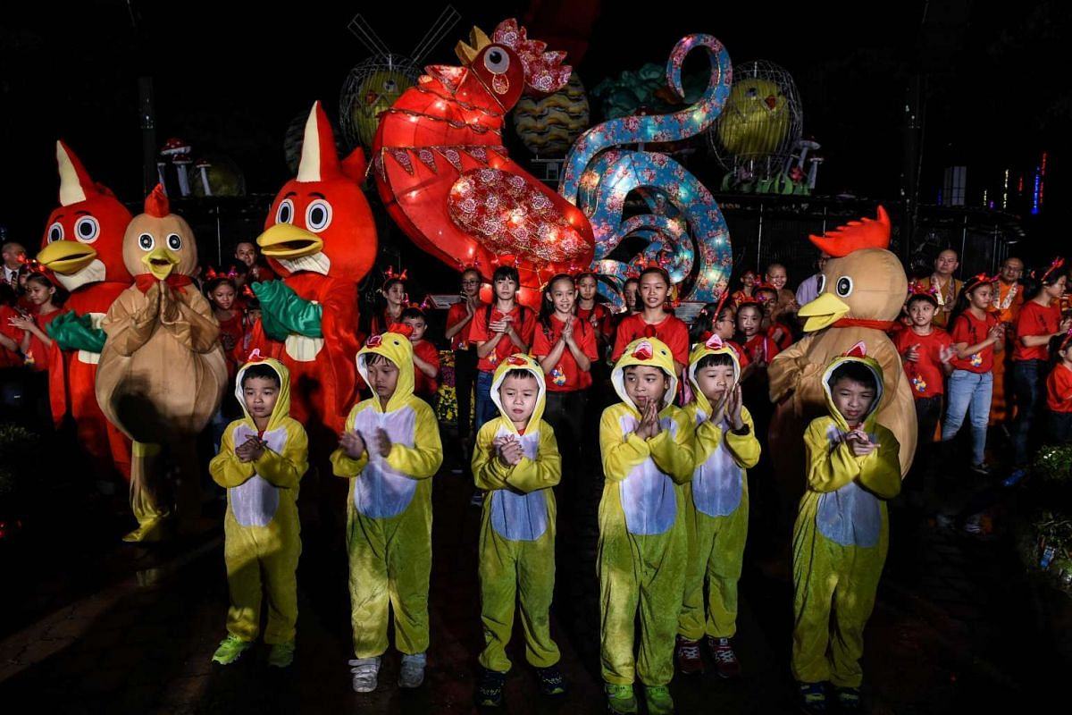 Children in rooster costumes dancing during the opening ceremony of the Lantern and Flora Festival ahead of the Chinese New Year celebrations at Fo Guang Shan Dong Zen Buddhist Temple in Jenjarom, west of Kuala Lumpur, on Jan 25.