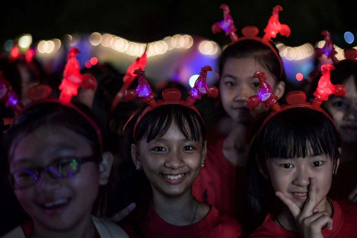 Girls wear illuminated rooster headgear during the opening ceremony of the Lantern and Flora Festival ahead of the Chinese New Year celebrations at Fo Guang Shan Dong Zen Buddhist Temple in Jenjarom, west of Kuala Lumpur, on Jan 25.