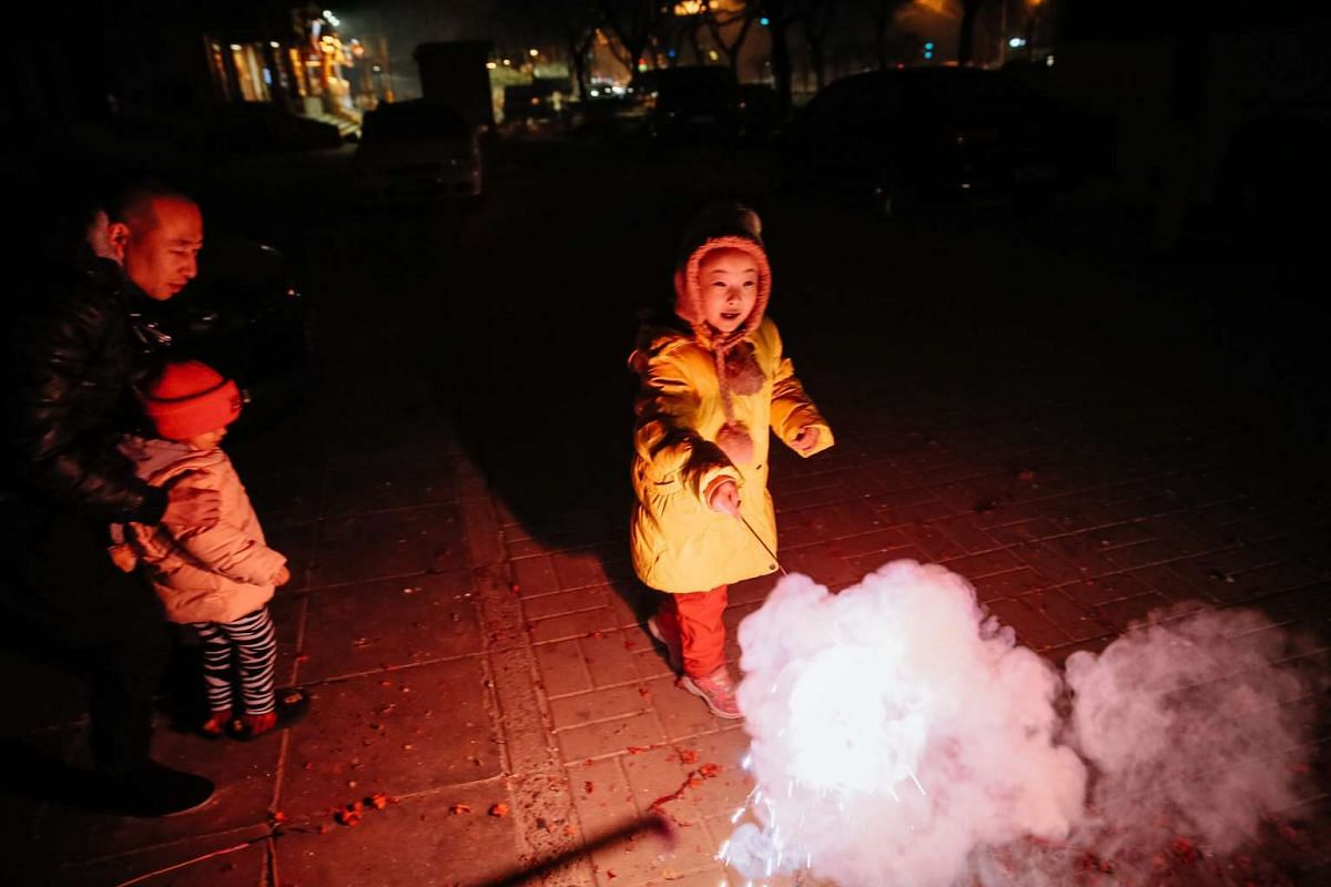 A young girl plays with sparklers to celebrate Chinese New Year in Beijing, China, on Jan 28.