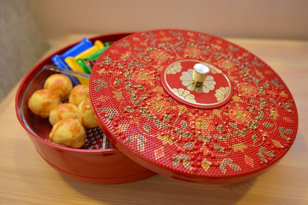 38-year-old circular plastic container (above) with a beaded design.
