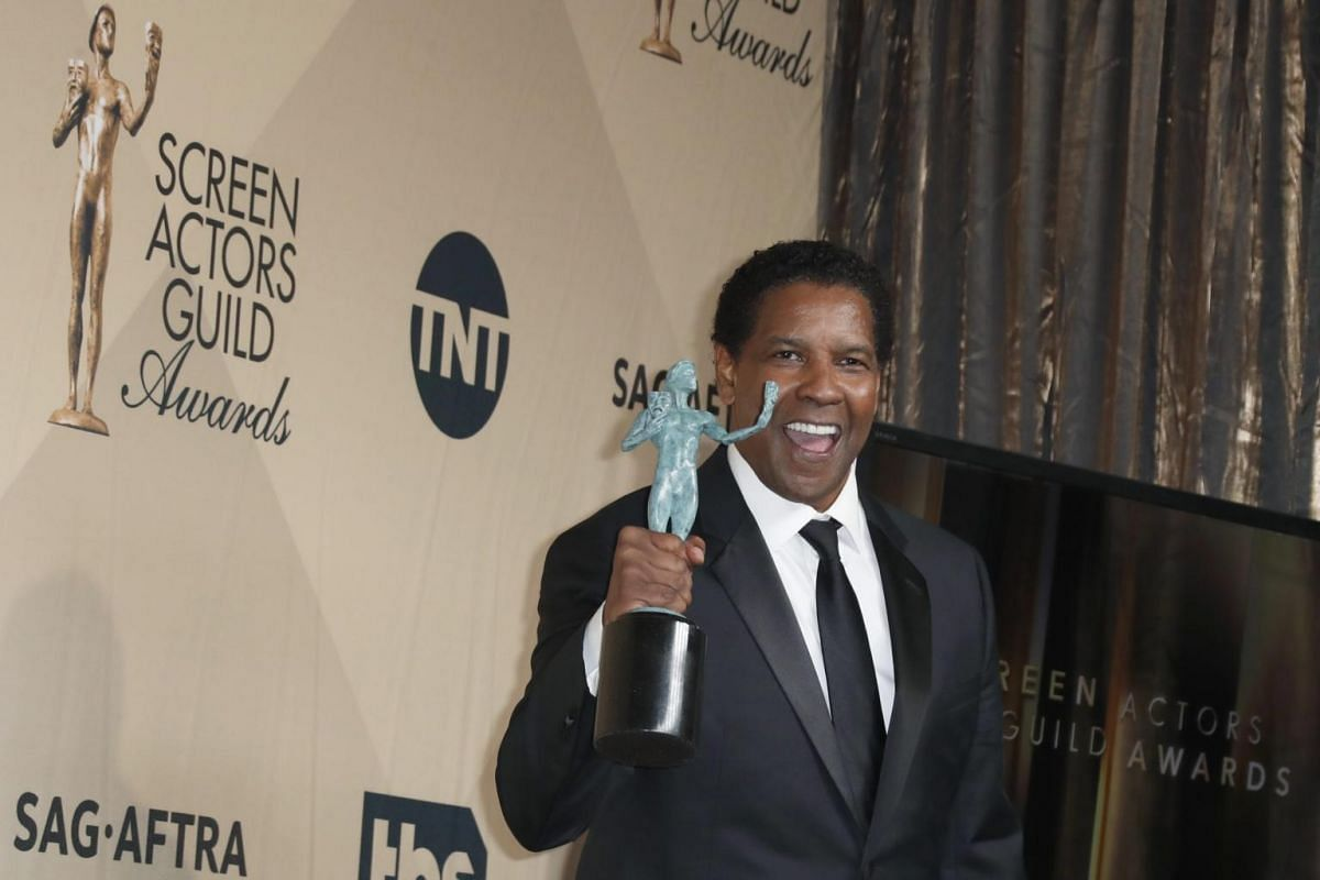 Denzel Washington poses with his SAG Award for Outstanding Performance by a Male Actor in a Leading Role for Fences at the Shrine in Los Angeles, California, on Jan 29, 2017.