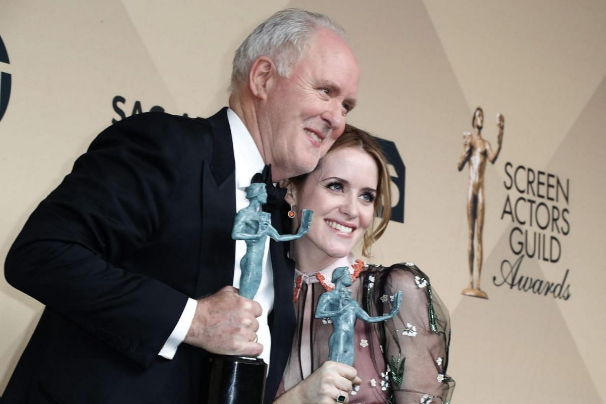 John Lithgow and Claire Foy pose with their SAG Award for Best Male and Female Actor in a TV Drama Series for The Crown at the Shrine in Los Angeles, California, on Jan 29, 2017.
