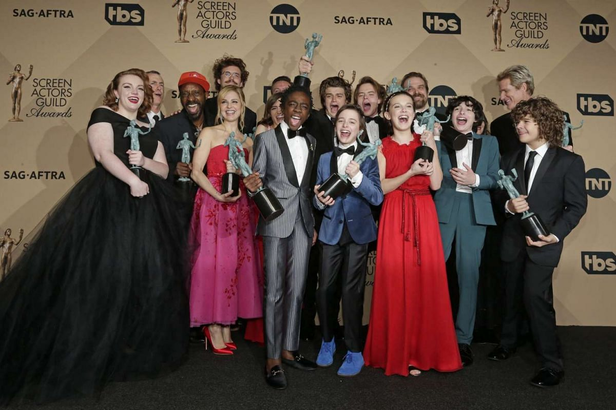 The cast of Stranger Things pose with the SAG Award for Outstanding Performance by an Ensemble in a Drama Series at the Shrine in Los Angeles, California, on Jan 29, 2017.
